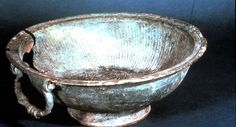 """This large, undecorated bowl, found at Sutton Hoo, is made of bronze and has two opposing handles. The term """"Coptic"""" refers to the fact that this bowl was made in Egypt.  Provenance: Sutton Hoo, England Dates from: VIIin century"""