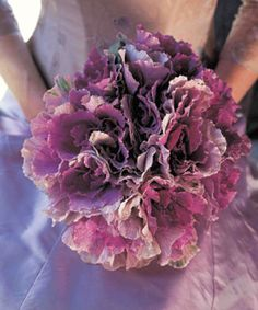 "This bouquet made entirely of ornamental kale fits perfectly with a lavender and cream color theme. It also gives a nod to our beloved Vermont, where there is no shortage of the signs ""Eat more Kale"" =)"
