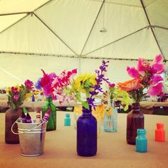 Small antique liquor bottles, one or two stems per bottle, bucks with crayons & butcher paper for center pieces! Simple yet elegant!