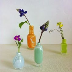 All these mini bud vases are painted mini bottles. I love this because I have a bunch of mini bottles and coloring them up would be so sweet. Just in time for spring!