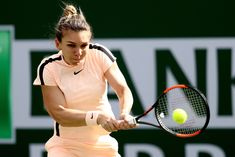 Simona Halep Photos - Simona Halep of Romania returns a shot to Petra Martic of Croatia during the BNP Paribas Open at the Indian Wells Tennis Garden on March 14, 2018 in Indian Wells, California. - BNP Paribas Open - Day 10