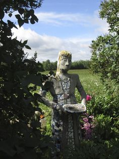 Lola my garden statue- metal mesh, concrete, glass mosaic sculpture.  Life size  Created by Deb Oswald