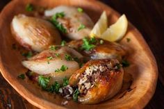 Lebanese Roasted Stuffed Onions Recipe - this looks out of this world for a night when dinner can take me more than 30 minutes! Lebanese Recipes, Jewish Recipes, Sukkot Recipes, Israeli Recipes, Arabic Recipes, Stuffed Onions, Stuffed Peppers, Kitchen Recipes, Cooking Recipes