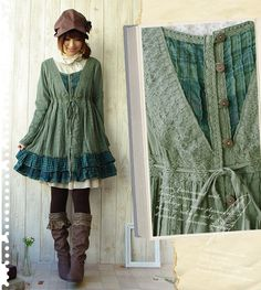 Mori, cute: Brown hat with flower detail. White dress. Green tunic. Black stockings. Brown boots.