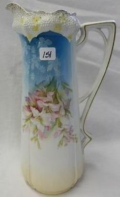 An RS Prussia porcelain Stippled Floral tankard with Clematis flowers.