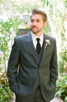 Gray suit with pink flower! YES! Photography: lane Dittoe fine art wedding photographs - lanedittoe.com Floral Design: Floral Occasions - floraloccasions.com/   Read More on SMP: http://stylemepretty.com/vault/gallery/13759