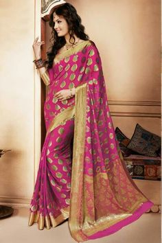 Pretty pink and gold georgette saree. Indian fashion.