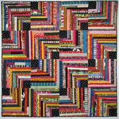 Exuberant Color: Quilts pieced with uneven width strips, love the thread flowers sewn over the blk squares on the quilt further down the page