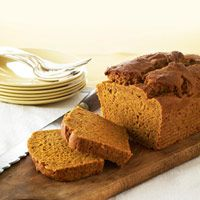 "Healthy Makeover Pumpkin Bread:  ""Treat family and friends to our slimmed-down quick bread. Gone are the traditional version's 3 grams of saturated fat and all the cholesterol (thanks to egg whites and a blend of low-fat yogurt and canola oil). No one will suspect you've tinkered — a slice is that good!"""