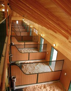 Custom horse stall partitions by Innovative Equine Systems sport a radiused curve that matches the curve of the stall front.