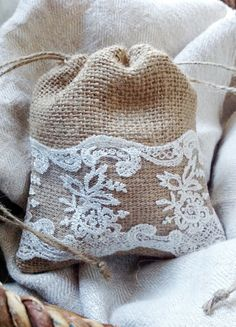 Burlap and lace drawstring gift bag for Bridesmaids. Glue/tack lace ribbon and add small flowers.