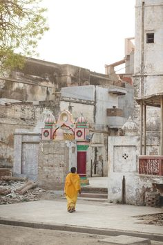 Local woman going through the streets of vrindavan early in the morning