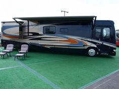 Class A Motorhome. A tailgaiting machine....love the ones with outside flat screen tv's, grills and side bathroom for visitors..