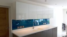 Large glass splashback in a beautiful blue. Includes socket cut-outs and angled details at the top corners to tie the wall units to the worktop width. Glass Splashbacks, Wall Units, Cut Outs, Color Splash, Clear Glass, Bathtub, Tie, Mirror, Beautiful