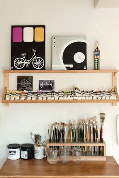 I love this homemade paint rack and brush holder from Joel Henriques' sneak peak on Design*Sponge . A really clever way to keep one's suppl...