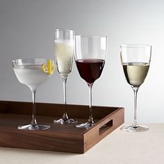 "Graceful wine glasses taper to squared-off base, creating a distinctive ""V"" where bowl meets stem. Crystalline glasses sparkle with the all the clarity of crystal yet without the lead."