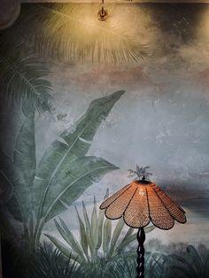 The Esplanade Hotel in St Kilda, Melbourne. #stkilda #espy #visitmelbourne #bottlegreen #greeninterior #distressedmural #relaxeddining #botanicalmural #botanicalinterior #juassicdecor #indoormural #interiormural #botanicaldecor #riparian #primordialchic #wildinterior #naturalmural #rusticcontemporary #muraldetail #palmtreemural #fronds #canelamp #vintagelamp #70slamp #ilovelamp #naturepainting Botanical Interior, Botanical Decor, Visit Melbourne, I Love Lamp, St Kilda, Rustic Contemporary, Nature Paintings, Vintage Lamps, Green