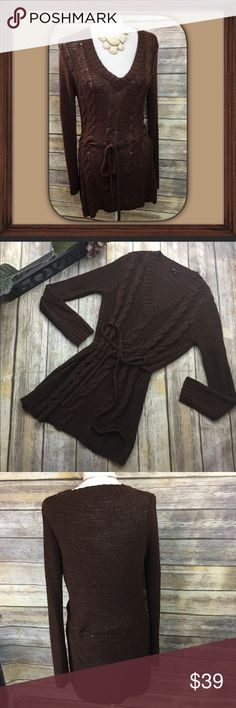 BCBGMAXAZRIA Brown Crochet Sweater Dress Size XL Brown v neck long sleeve sweater dress. Size XL. In excellent used condition. 38 inches long. 27 inch sleeves. 20 inches arm pit to arm pit without stretching material laying flat. Comes with belt . BCBGMaxAzria Dresses Long Sleeve