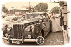 Bride getting into the wedding car. New Zealand wedding photography http://www.paulmichaels.co.nz/ PaulMichaels Wellington photographers.
