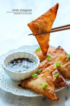 Crab Rangoon - This crisp, fried wonton is loaded with cream cheese and crab goodness, and it's an absolute party favorite! @Chung-Ah Rhee
