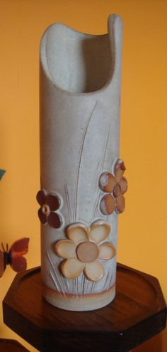 clay flowers bud vase. $14.00, via Etsy.