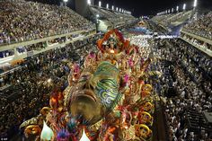 Tens of thousands of people gathered on both sides of the imposing venue to watch and sing along to Rio's famous Samba schools