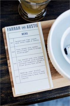 Wooden plank placemats with rubber-banded menu attached. #weddingchicks Captured By: Lightbox Photography http://www.weddingchicks.com/2014/06/20/funky-braided-wedding/