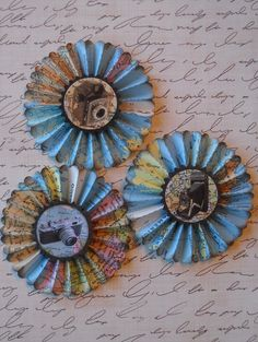A gorgeous set of rosettes made from recycled vintage maps and embellished with beautiful images.    You will receive three as pictured, they may