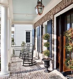"""Unforgettable Front Porches — Set in Stone (Glo.msn.com, photo courtesy of Houzz/Jamison Howard) (""""This beautiful porch in Charleston was constructed from the same bricks that are on the walls of the home [Boral Shadow Stone with Savannah ivory mortar]. The traditional beadboard ceiling is covered in Duron Paint's Piazza Blue."""")"""