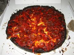 That's not a burnt crust, silly, that's a PEQUOD'S crust. What's that? Just the most amazing pizza you will ever dream of eating, that's what.