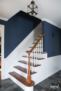 A look at my newly painted entryway. Color: Farrow and Ball Stiffkey Blue Dark Blue Hallway, White Hallway, Blue Hallway Paint, Hallway Colours, Room Colors, Hall Paint Colors, Stair Walls, Stairs, Blue Living Room Sets