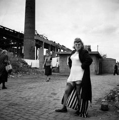 by David Seymour Prostitute near the Krupp works, Essen, 1947.