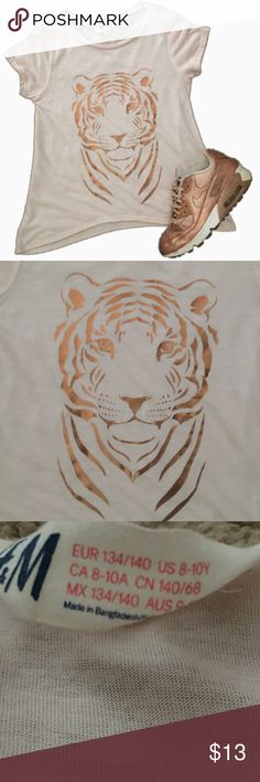 Girls H&M Pink + Gold Tiger Graphic Tee Girls H&M very pale/light pastel pink color tee with tiger Graphic in rose gold color. Excellent condition. Never worn. Size medium (8-10) H&M Shirts & Tops Tees - Short Sleeve