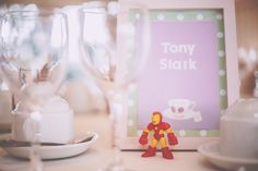 Our geeky wedding tables ft Iron Man - Table name by Mary Loves Bob - Photo by Noel Deasington
