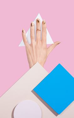 Ania really likes negative space nails. She'd like to do something like this in a metallic gold for the 2nd manicure look.