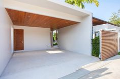 Interior and exterior design of white carport with wooden ceiling and wooden gated area , Exterior Design, Interior And Exterior, Building A Carport, Diy Photo Backdrop, Carport Designs, Style Minimaliste, Wooden Ceilings, Home Safes, Portal