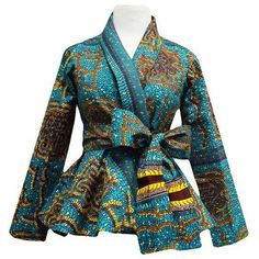 Style Stand out in our beautiful Diola African print blazer. This African print blazer features a teal and yellow African print, with a slimming peplum style fit. Pair this blazer perfectly wi African Inspired Fashion, African Print Fashion, Africa Fashion, African Print Dresses, African Fashion Dresses, African Dress, African Prints, Ankara Fashion, Ankara Tops
