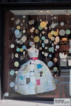 Multi-colored/sized hanging dots. Paper sculptures. make an outfit out of race bibs