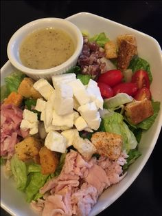 The Italian Job Salad: Chopped Romaine, Turkey, Salami, Ham Mozzarella, Red Onion, Tomato, Croutons, Parmesan Cheese  Red Wine Vinaigrette.