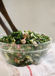 Fresh kale salad with sliced apples, dried cranberries and pecans