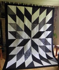 Made from 1\2 square triangles. 6 x 8. Probably 8 1\2  or 10 inch blocks.