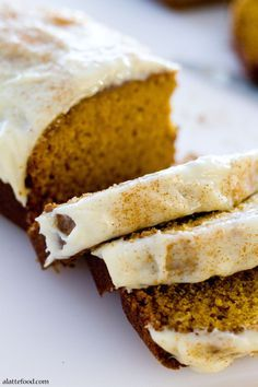 This classic pumpkin bread is sweet, full of cinnamon, and topped with both streusel and a cream cheese glaze! | www.alattefood.com