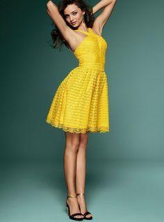 Miranda Kerr in vintage-inspired yellow dress