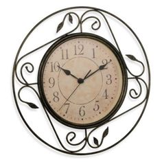 Geneva Wrought Iron Wall Clock - BedBathandBeyond.com This would look great in our kitchen, just need to measure if it would fit