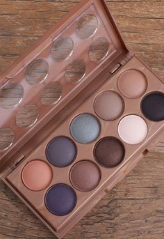 """All your wildest dreams have come true with this limited edition NYX Dream Catcher Palette in """"Stormy Skies"""". Featuring a set of 10 different pressed powder eye shadows to create a variety of makeup l"""
