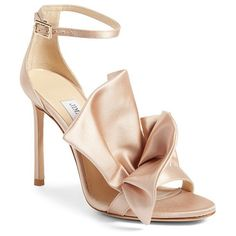 kami ruffle sandal by Jimmy Choo. Twin rows of fanned satin ruffles perch on the barely-there toe strap of a shimmery sandal lifted skyward by a slende...