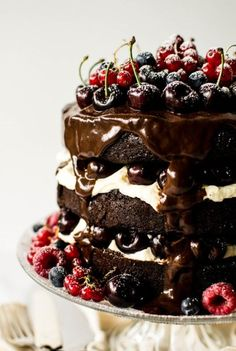 Black Forest Gateau German Black Forest Gateau Cake _ It consists of 3 dense, rich layers of dark chocolate cake that are drenched in kirsch syrup, topped with macerated kirsch cherries, a fluffy mascarpone cream frosting, & a dark chocolate ganache. Galette Des Rois Recipe, Gateau Cake, Cake Recipes, Dessert Recipes, Pie Dessert, Yummy Recipes, Black Forest Cake, Black Forest Birthday Cake, Dark Forest