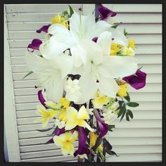 Cascade bouquet, white lilies, purple calla lilies, stephanotis, plumeria, la flora couture