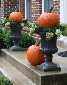cute pumpkin topiaries in front porch urns by eleanor