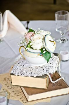The reception table DIY centerpieces... I like the books! Could even be read during slower times!